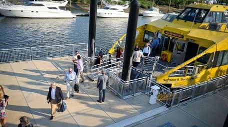 Commuters disembark at the Glen Cove Ferry Terminal