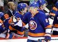 Islanders defenseman Scott Mayfield (24) is congratualted by