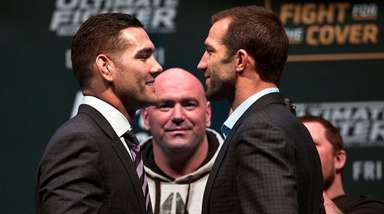 Chris Weidman, left, smiles at his opponent Luke