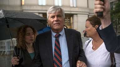 Dean Skelos, center, and his wife, Gail, right,
