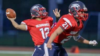 Raymond Costa #12 of Cold Spring Harbor throws
