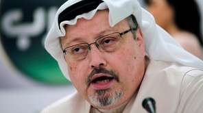 Saudi journalist Jamal Khashoggi speaks during a news