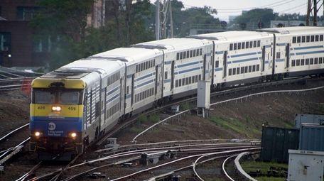 An eastbound bi-level Long Island Rail Road train