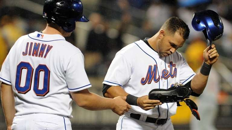 Carlos Beltran, right, strikes out to end the