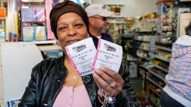 Liz Jackson of Roosevelt shows her Mega Millions