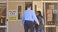 Voters head into Great Hollow Middle School in