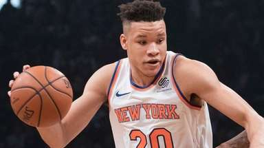 Knicks rookie forward Kevin Knox, left, works against