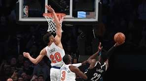 Brooklyn Nets guard Caris LeVert scores the winning