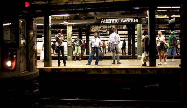 Commuters wait at the Atlantic Terminal subway station,