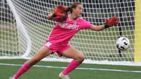 Northport's Bailey Piper (18) makes a save in