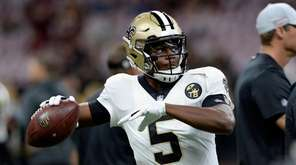 New Orleans Saints quarterback Teddy Bridgewater (5) warms