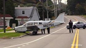 A small single-engine plane came to a halt