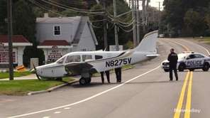 A small single-engine plane came to a halt