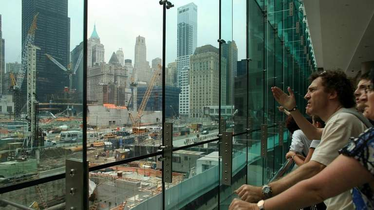 People watch construction at The World Trade Center