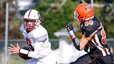 Anthony Caputo #9 of Clarke runs the ball