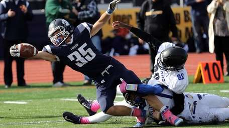 Northport's Justin Gerdvil (35) reaches over the goal