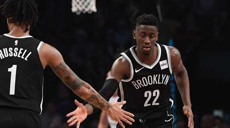 Brooklyn Nets guard Caris LeVert, right, and Nets
