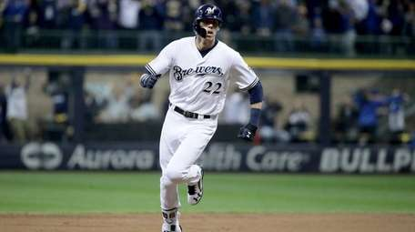 Christian Yelich #22 of the Milwaukee Brewers celebrates