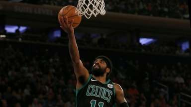 Kyrie Irving #11 of the Boston Celtics lays