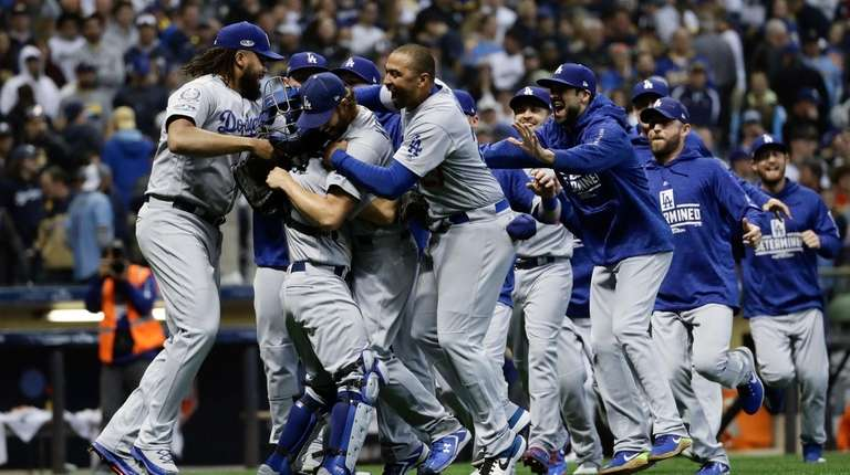 The Los Angeles Dodgers celebrate after Game 7