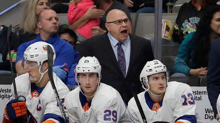 New York Islanders head coach Barry Trotz, top
