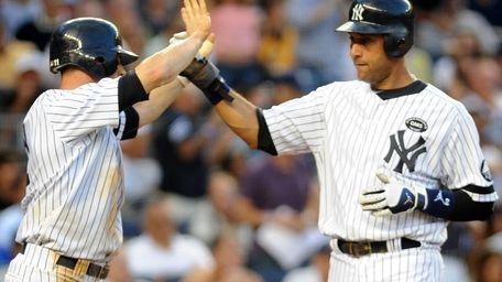 New York Yankees' Brett Gardner (11) high fives