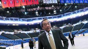 Charles Wang walks through Nassau Coliseum after addressing