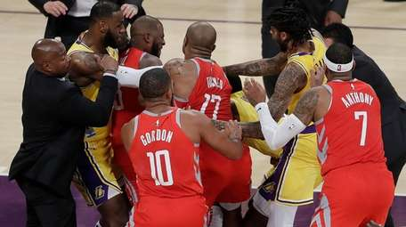 The Rockets' Chris Paul, second from left, is