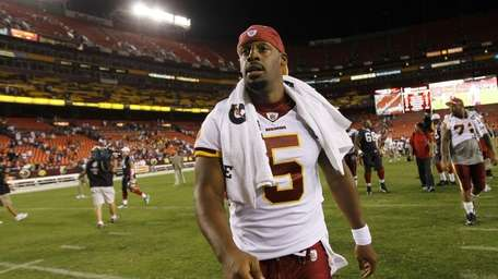 Washington Redskins quarterback Donovan McNabb walks off the