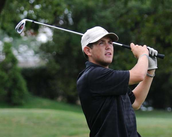 Eric Lewis, 20, of Bellmore tees off from