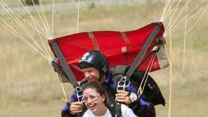 Harnessed to a professional skydiver, Lindsay Doyle ,