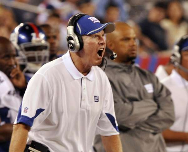 Tom Coughlin yells to his players late in