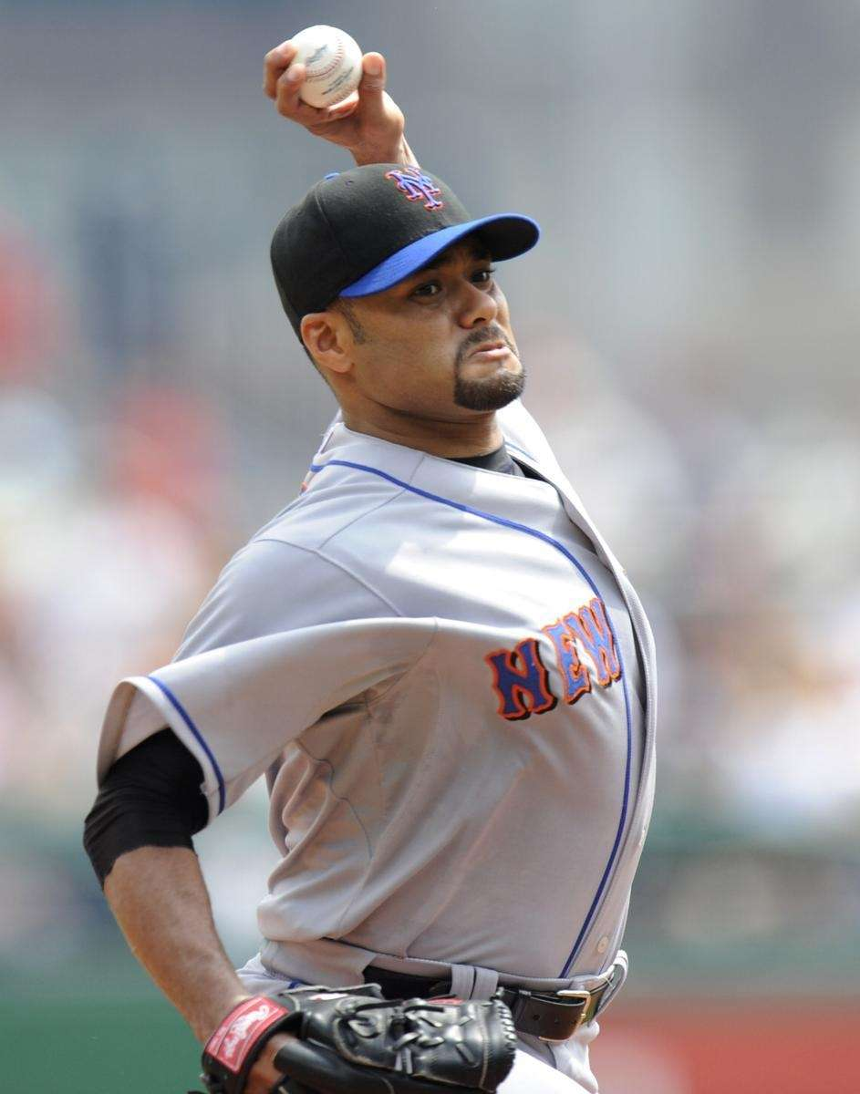 New York Mets pitcher Johan Santana delivers against