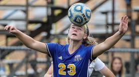 Emma Terino of East Meadow heads the ball