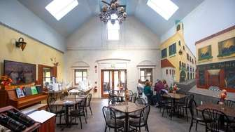Guests sit inside Diliberto Winery in Jamesport on
