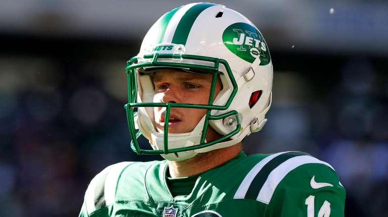 Sam Darnold of the Jets looks on against