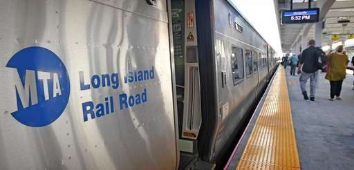 Commuters at the Hicksville LIRR station make their
