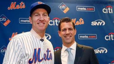 Todd Frazier, poses for photographers with his agent,