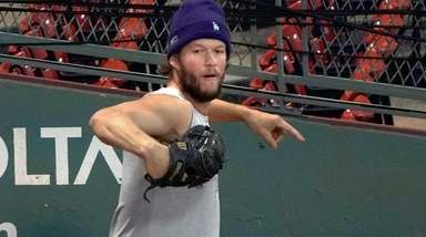 Dodgers pitcher Clayton Kershaw warms up in the
