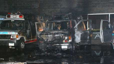Private ambulances damaged in a fire in Holbrook