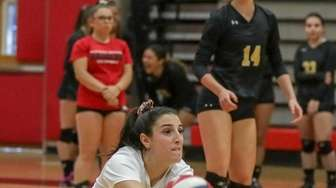 Emily Haber #2 of Commack digs up a