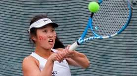 Syosset's Sarah Wong hits a backhand during the