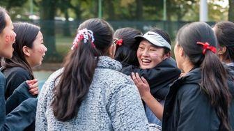 Syosset's Sarah Wong celebrates with teammates after winning