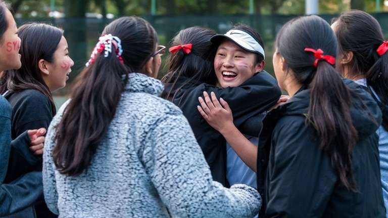 Syosset's Sarah Wong celebrates with teammates after winning