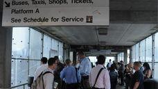 Delayed commuters wait for a 7:32 a.m. train