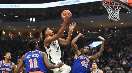 The Bucks' Giannis Antetokounmpo drives to the basket