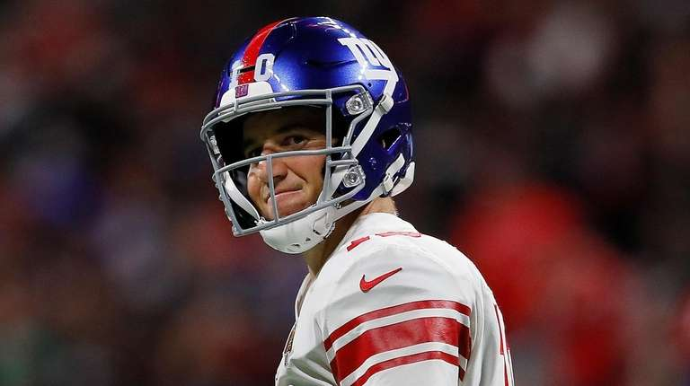 Giants quarterback Eli Manning reacts after being sacked