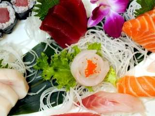 Sushi and sashimi combos are artistically plated at