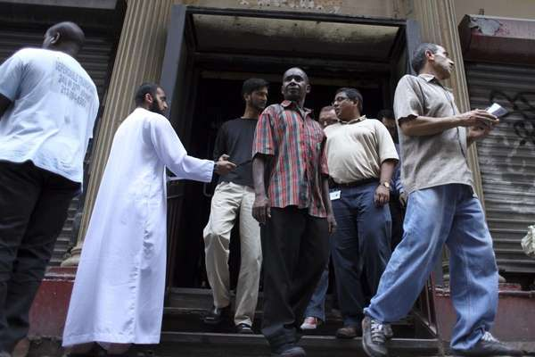 Worshipers leave Friday prayer service at the site