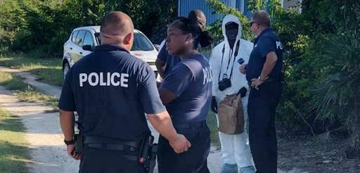 Turks and Caicos Islands Police Force officers investigate